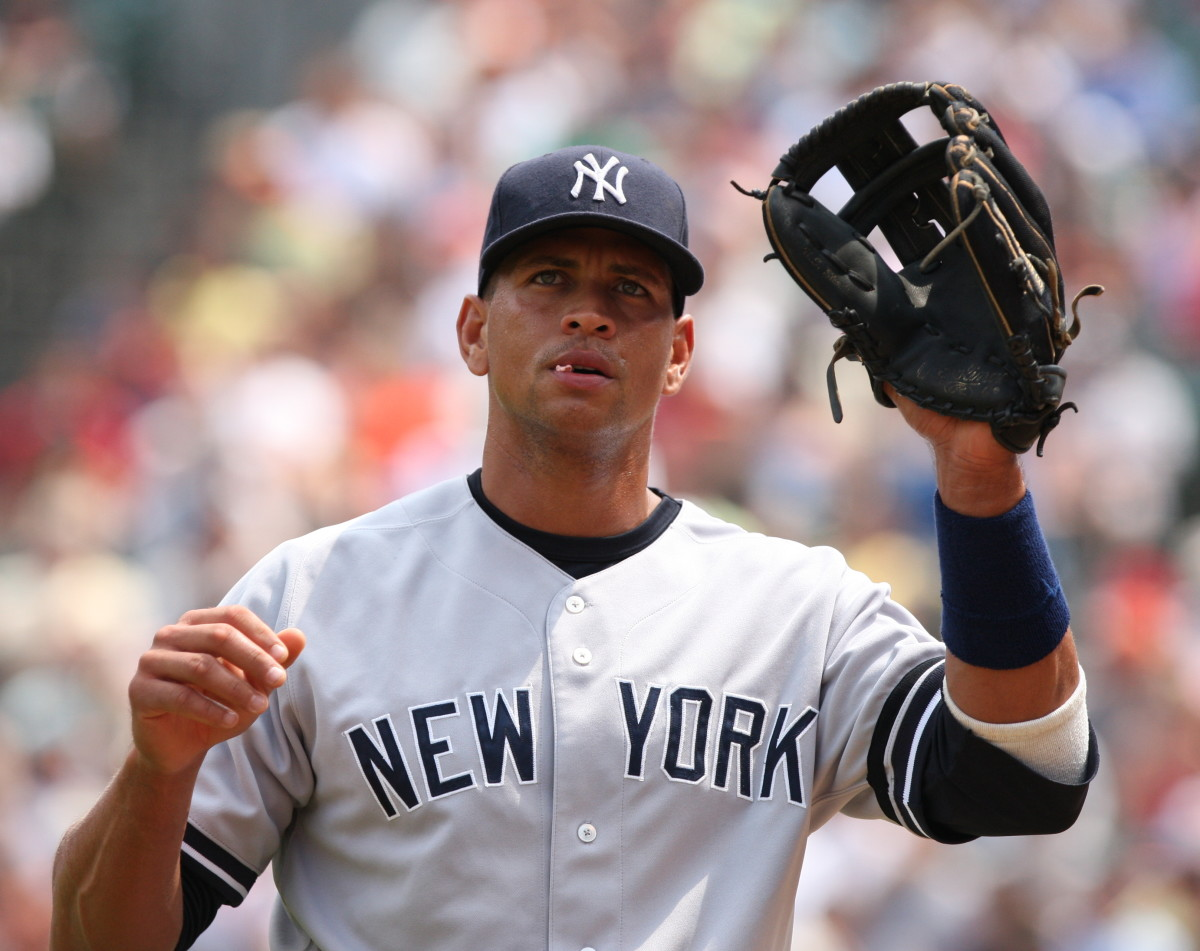 Alex Rodriguez, seen with the New York Yankees in 2007, is credited with being the first player to sign a mega-contract. He inked a deal for 10 years and $252 million with the Texas Rangers, then opted out to sign with the Yankees for $300 million.