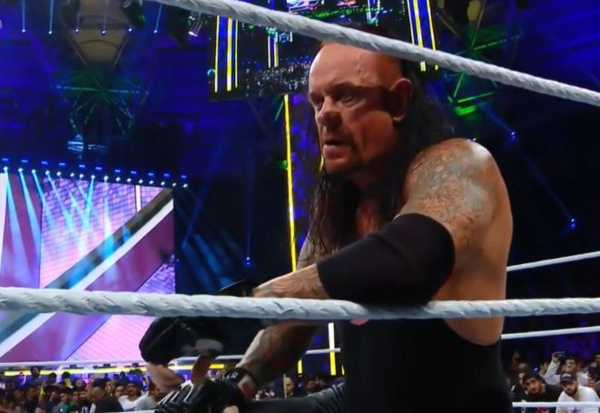 Taker's face just says it all.