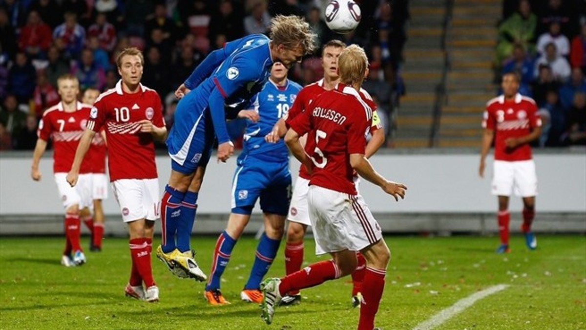 Iceland's Birkir Bjarnason heads in a goal during Iceland's 2011 UEFA U-21 Championship match against Denmark in Aalborg. Birkir became Iceland's first goalscorer at a major tournament when he scored against Portugal at Euro 2016.