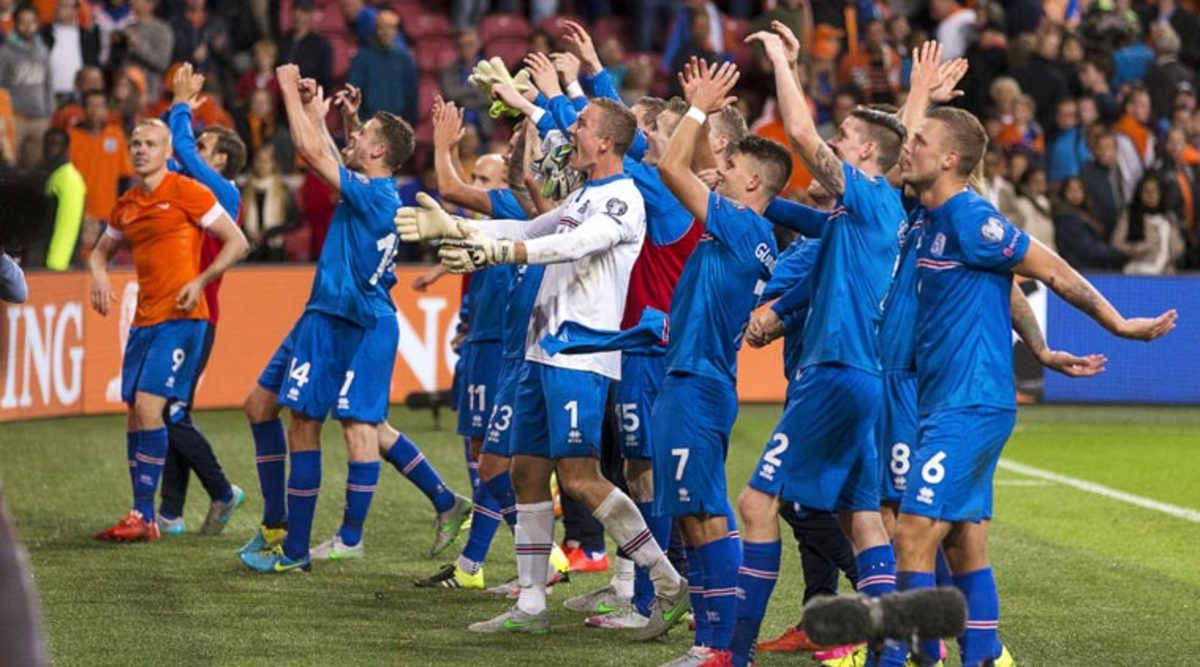 Iceland players celebrate with fans following a Euro 2016 qualifier at the Amsterdam Arena. The 1-0 victory against the Netherlands marked a significant milestone that helped Iceland secure qualification for Euro 2016.