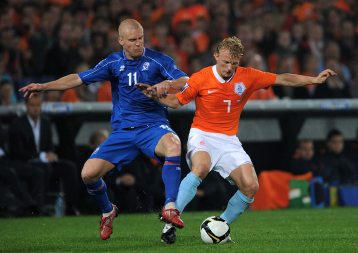 Iceland's Emil Hallfredsson battles with the Netherlands' Dirk Kuyt during a 2010 FIFA World Cup qualification match in Rotterdam, Netherlands. Iceland lost the match 2-0, one of five it suffered in the five-team group
