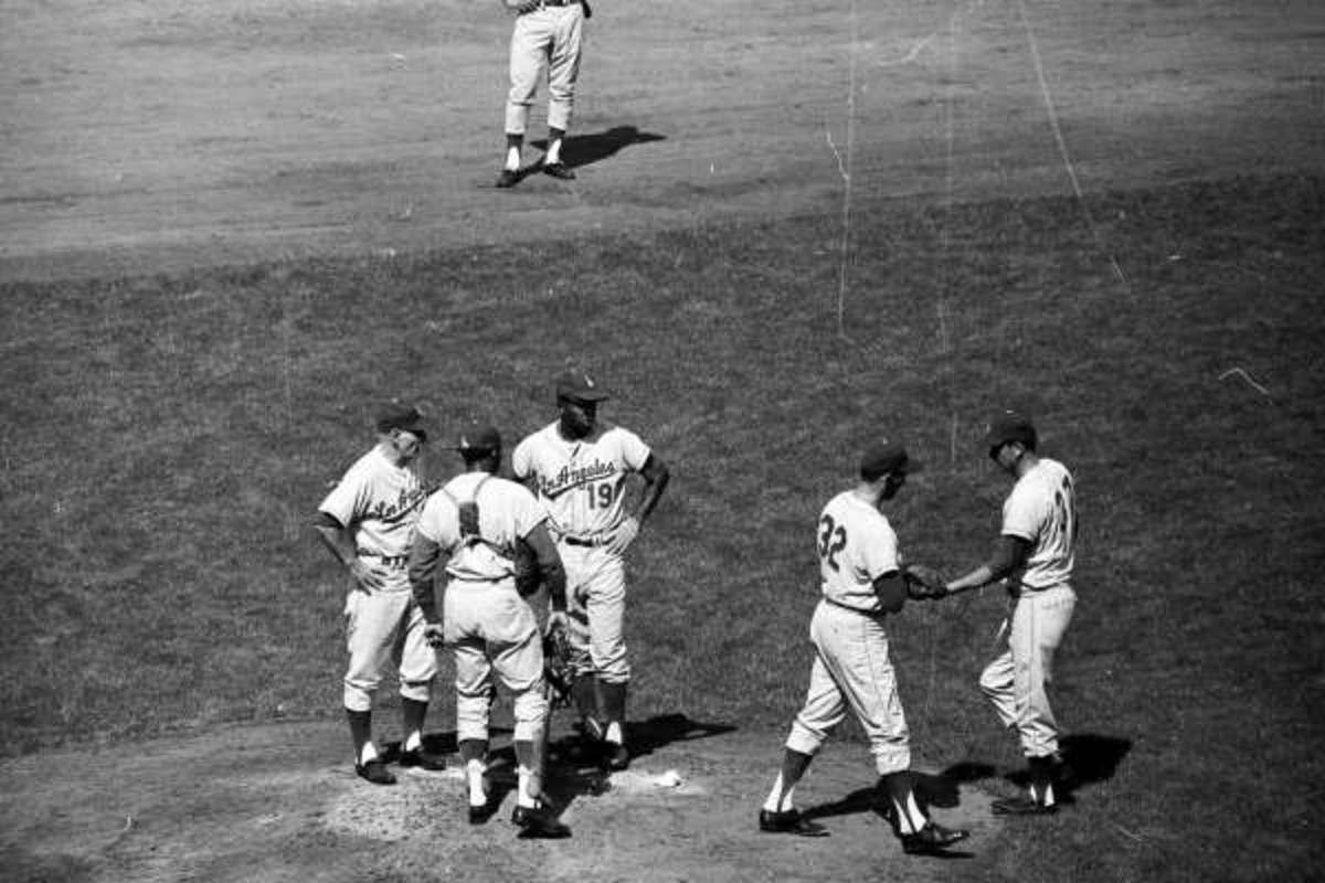 Koufax is lifted in the 2nd inning by Leo Durocher.  Alston often sent Durocher out to make pitching changes.