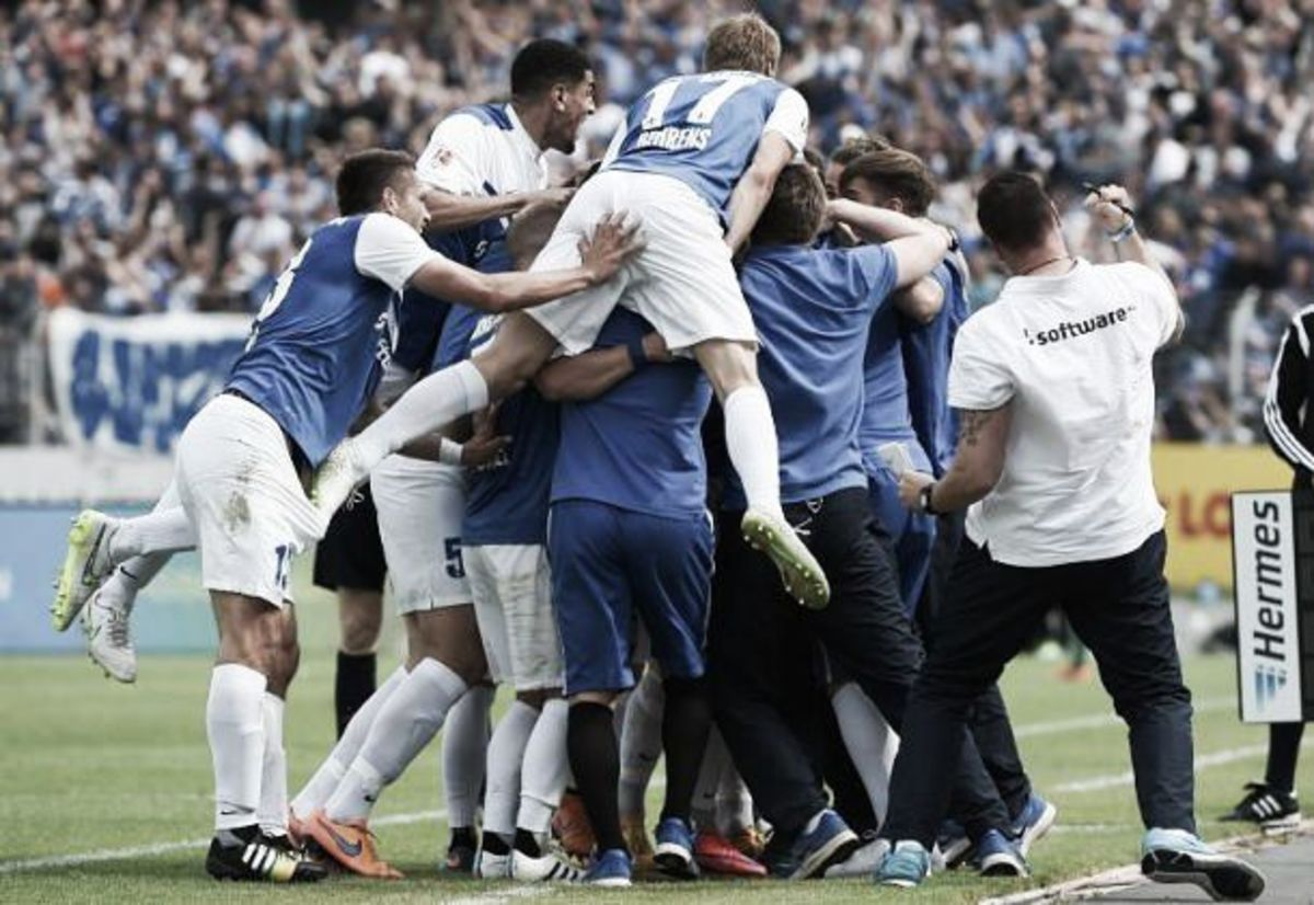 Hanno Behrens (#17) jumps onto a pile of personnel during SV Darmstadt 98's match against FC St. Pauli on May 24, 2015. The 1-0 victory secured the club's return to Bundesliga after a 33-year absence.
