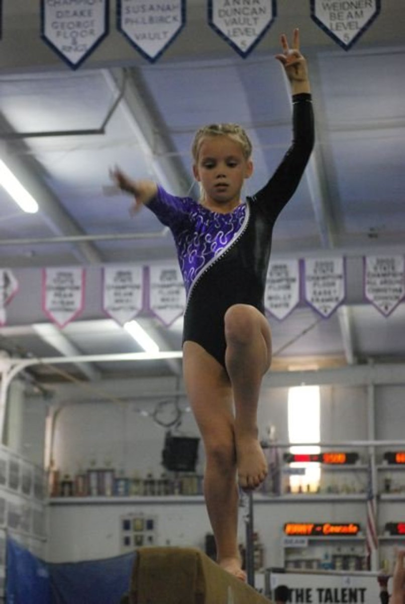 Balance beam pose in Level 5 routine