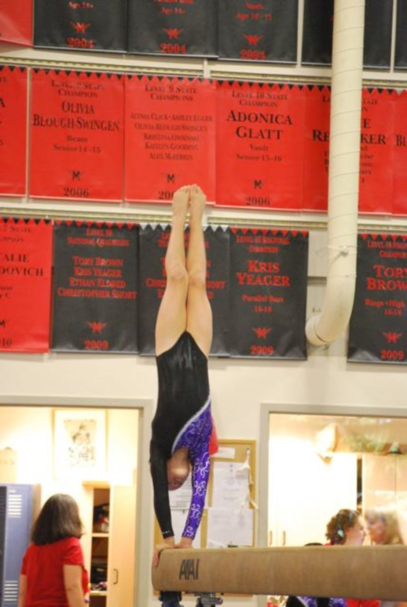 Handstand on beam in Level 5 routine