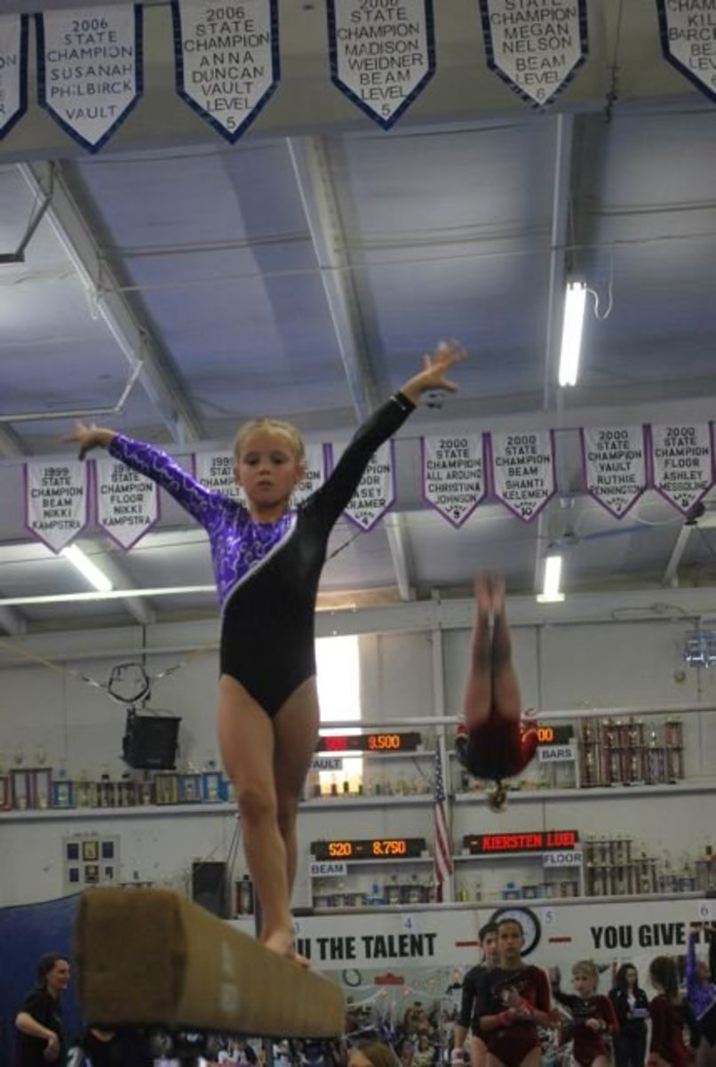 Finish pose on balance beam