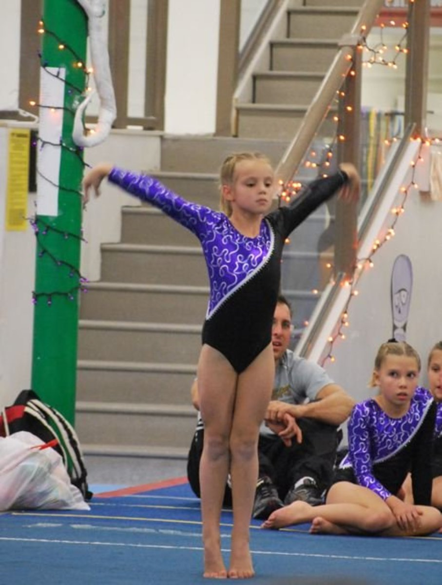 Preparing for final tumbling run in Level 5 gymnastics floor routine