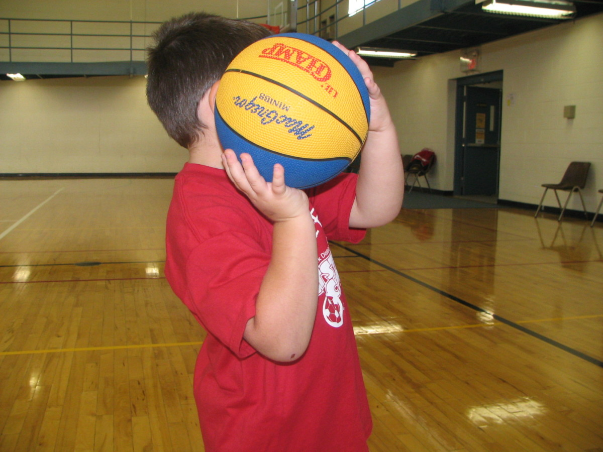 Boy in basketball shooting position