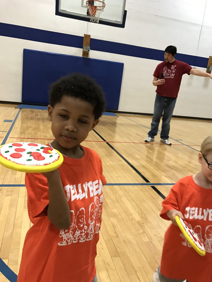Boy holds foam pizza
