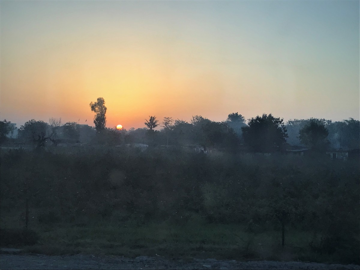 Sunrise from the train window .... Vanita Thakkar