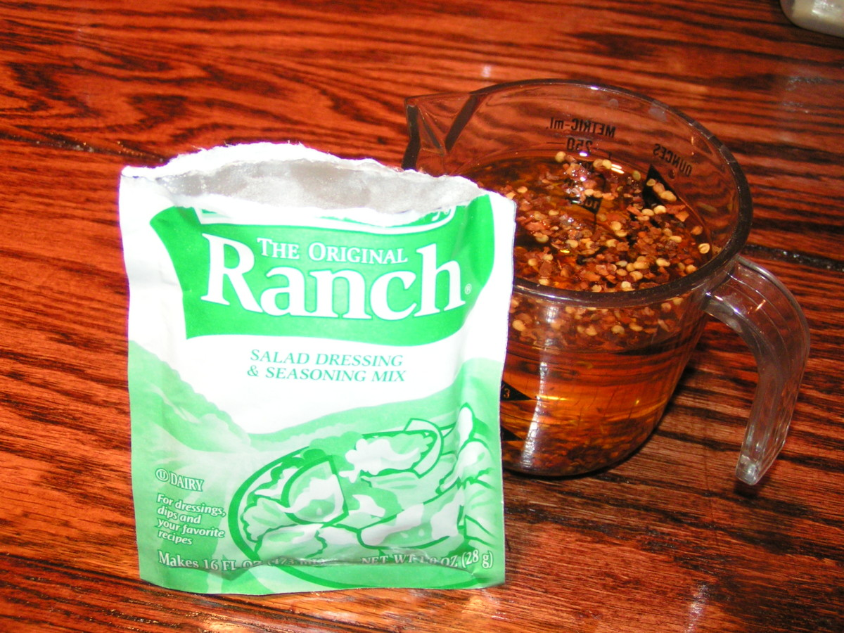 Pour the contents of the packet of ranch dressing into the oil and chili mixture and whisk.