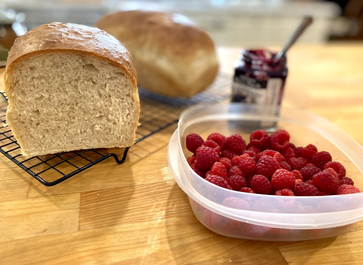 Fresh bread with preserves and fresh berries on the side