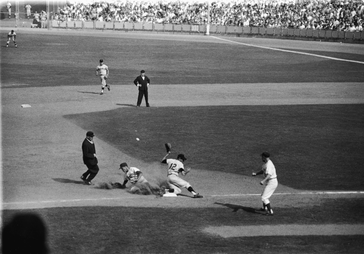 7th Inning - Wills steals third and scores on  catcher Ed Bailey's errant throw.