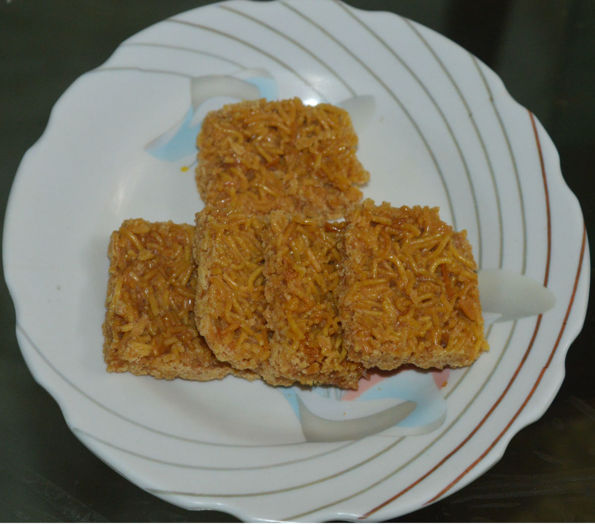 Sev chikki (sweet and crunchy gram flour noodle bars)
