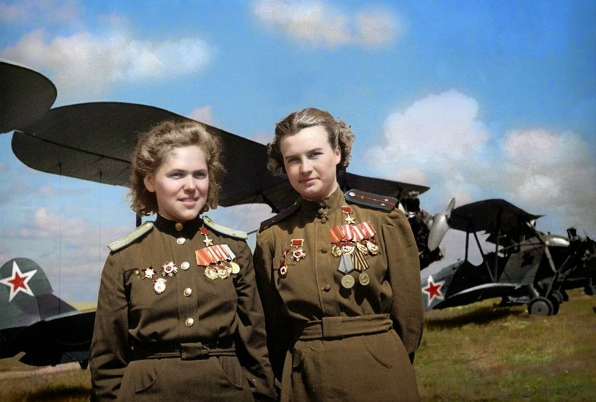 Two Night Witches in front of plane