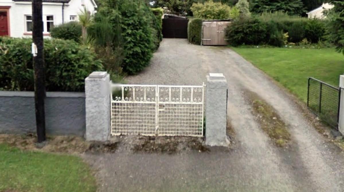 Narrow driveway entrance.