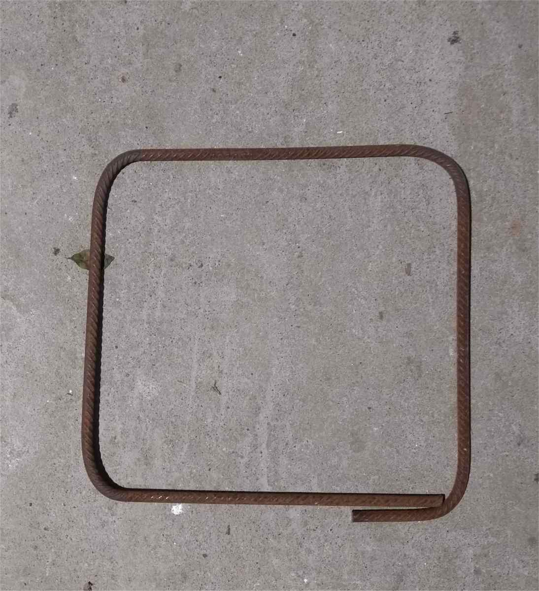 """Square ring or """"stirrup"""" made from rebar."""