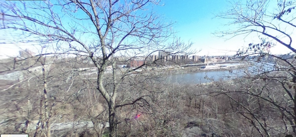 A winter view of the Harlem River behind Highbridge Pool where Peebles says he threw the gun. In July 1950, vegetation would have nearly obscured the river making an accurate toss impossible.