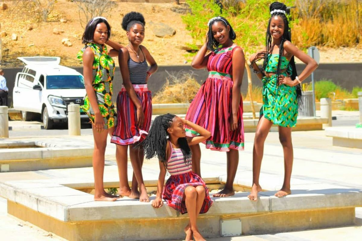This is a picture that shows women wearing the Owhiwambo traditional attire while some are wearing African attire.