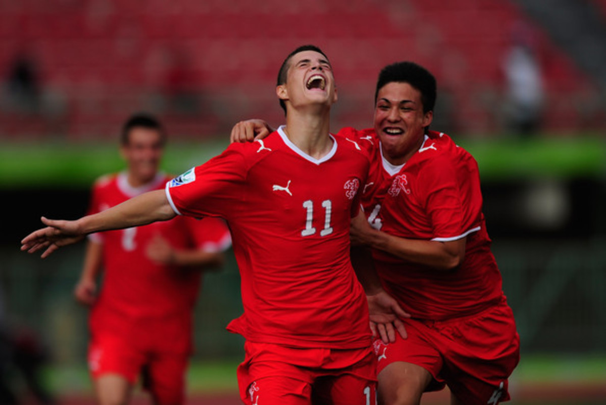 Granit Xhaka (11) celebrates with teammates after scoring the go ahead goal against Japan in a FIFA U-17 World Cup match against Japan.