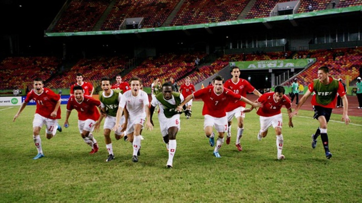 Swiss players celebrate after winning its match against Brazil 1-0 as Switzerland won all three games in the group stage.