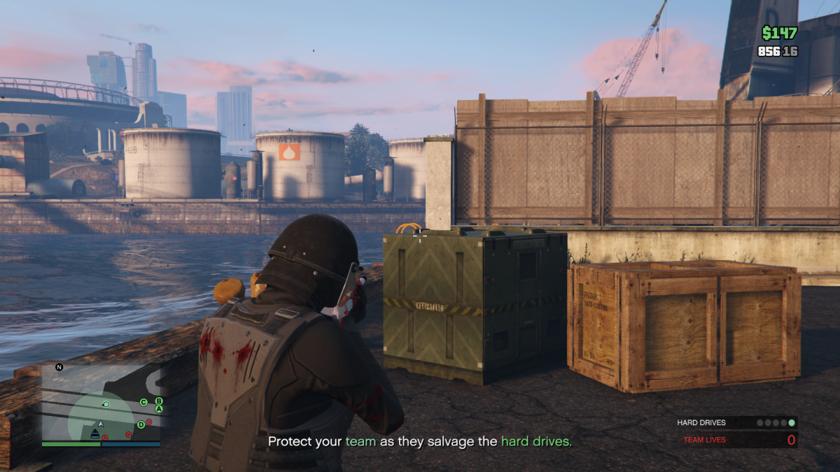 On the other side of that green crate is just enough dock to walk along. Here you can flank around to the other side of the area without getting shot too much.