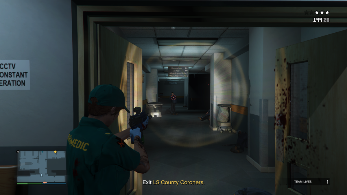 When the Paramedic gets back down to the ground floor the lobby will be filled with Agents. Take cover at THIS doorway.