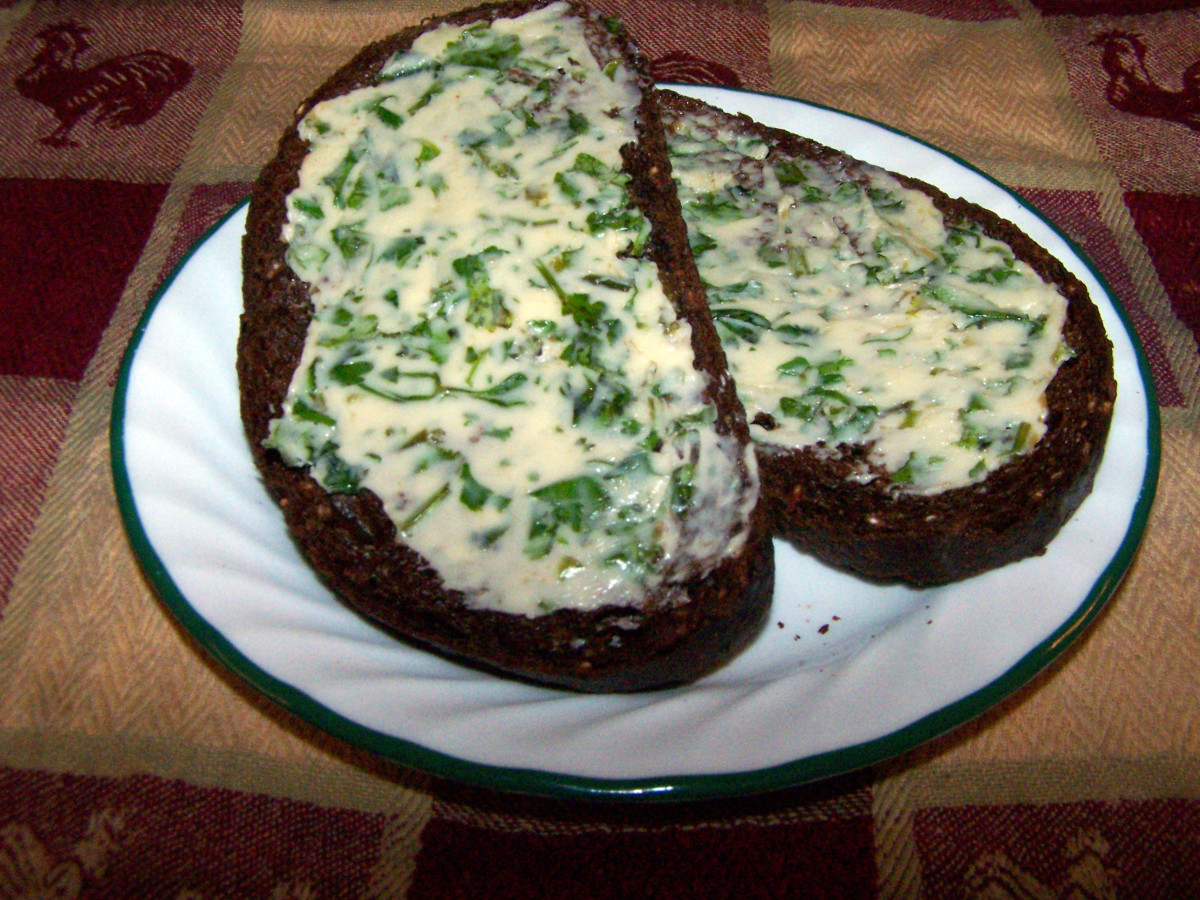 Homemade herbal butter on pumpernickel