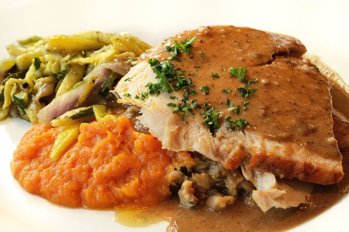 Thanksgiving dinner: roasted American turkey with French bread dressing, bourbon-whipped sweet potatoes, grilled autumn vegetables, and giblet gravy—yum!