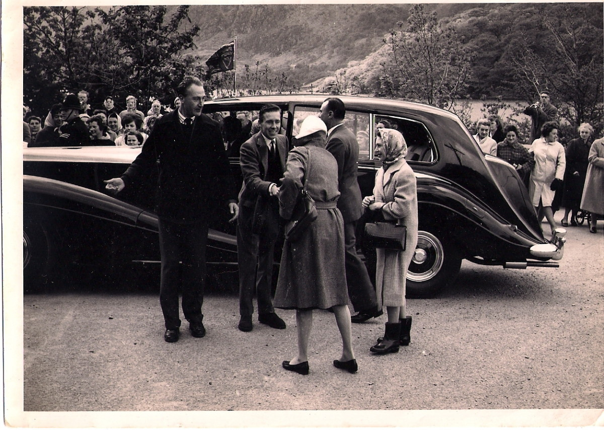 Princess Margaret and Lord Snowdon being welcomed to Llanberis  (Ann's head just above the car bonnet, her father standing on the wall, rear right, with camera)