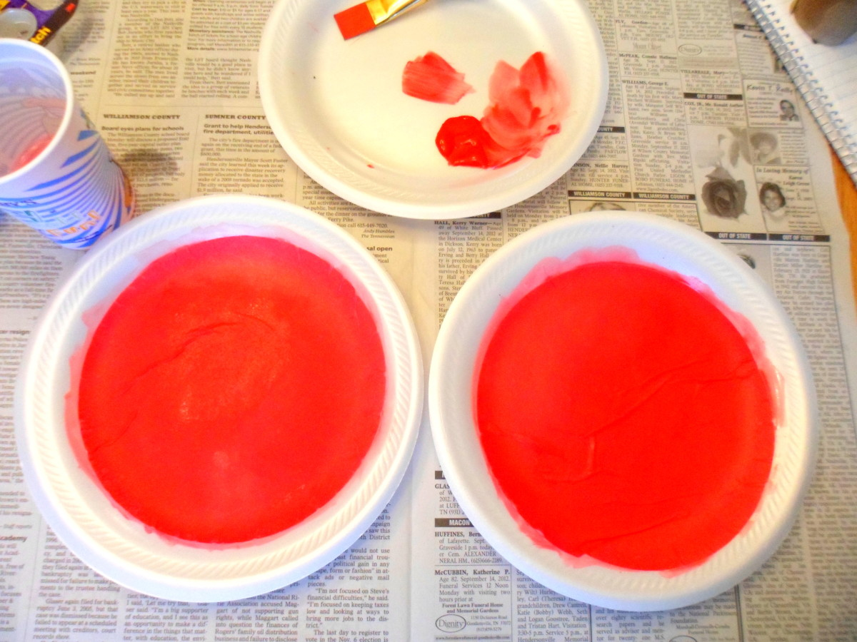 Paint coffee filters red and let dry.