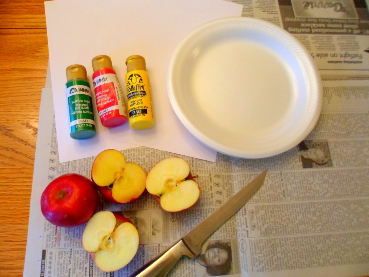 The supplies to create apple stamps.