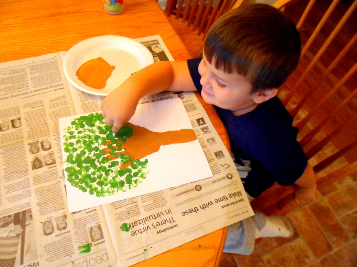 Make leaves using green paint and your child's fingerprints.