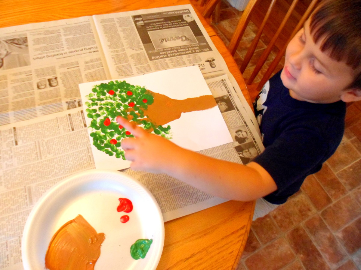 Make apples using red paint and your child's fingerprints.