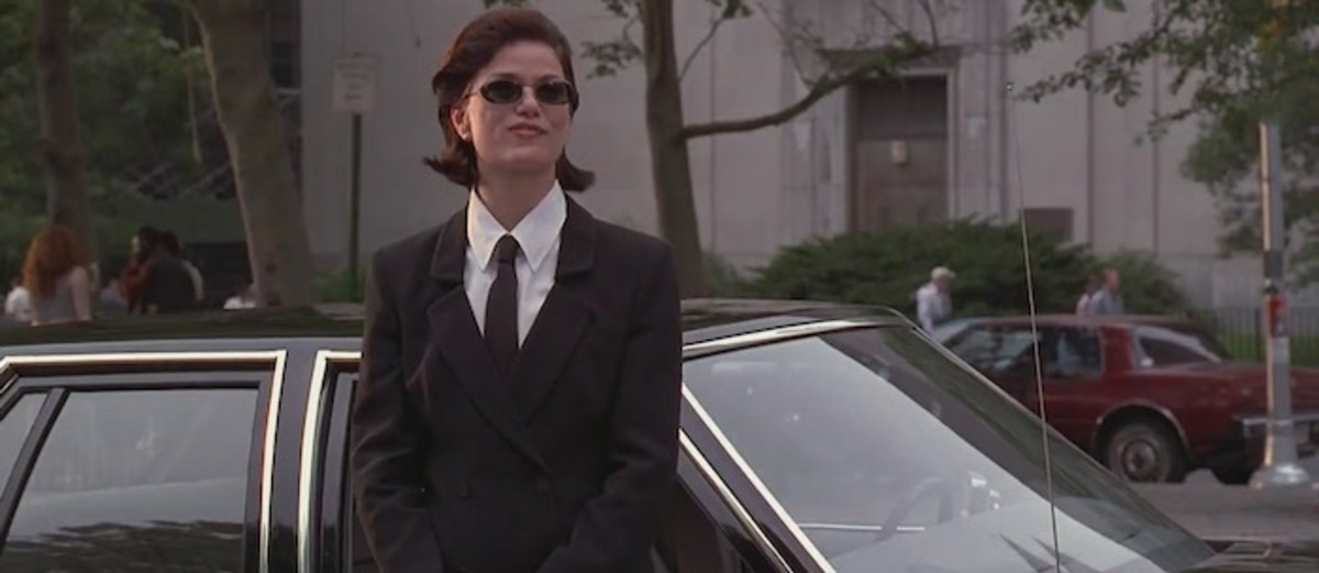 Agent L waits for J to get a hotdog.