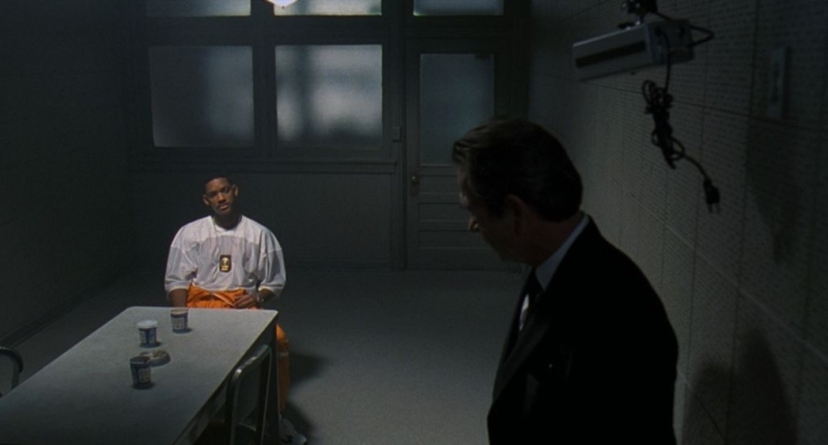 Agent K interrogates James.