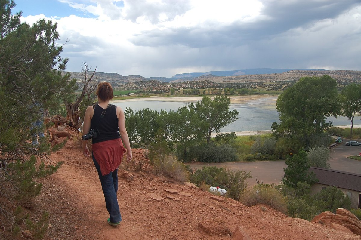 Hiking the trail in the park with a view of Wide Hollow Reservoir below