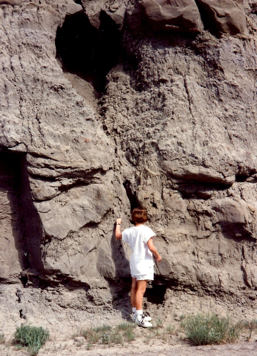 My niece knocking on a petrified sand dune.  Sounds hollow!