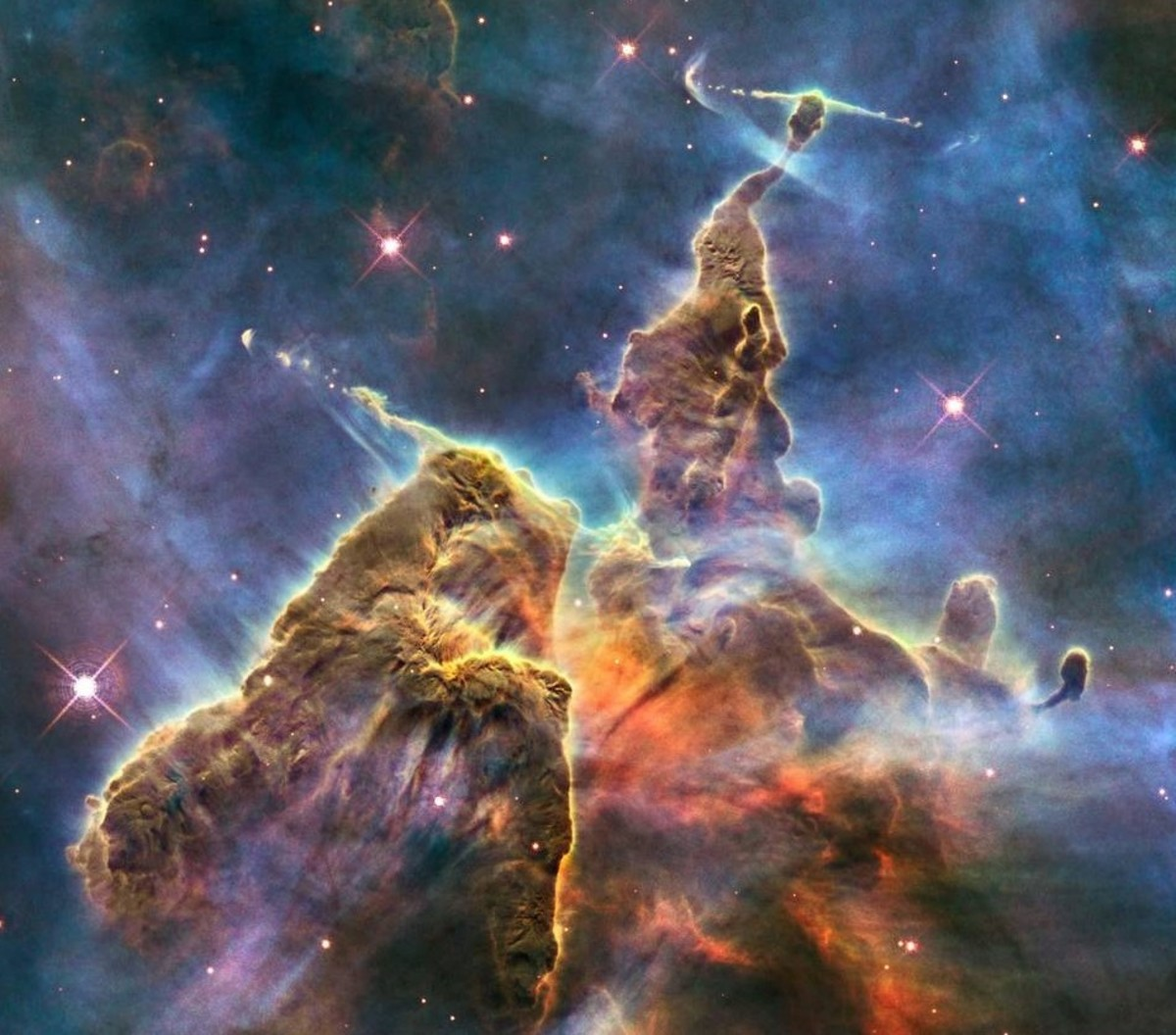 Hubble Space Telescope photo is but a small portion of one of the largest seen star-birth regions in the galaxy, the Carina Nebula. Towers of cool hydrogen laced with dust rise from the wall of the nebula.