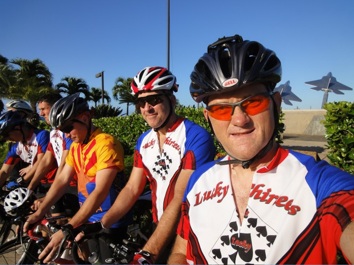 The Lucky 13s in front of the HICKAM AFB sign near the Officer's Club and adjacent to the Pearl Harbor channel entry