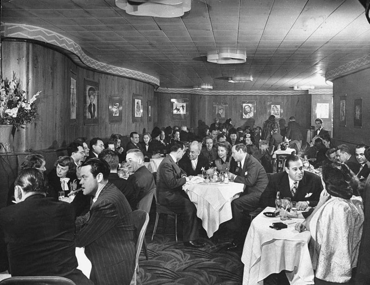 A rather stiffly posed image from the Stork Club in 1944. Orson Wells is in the foreground left. Billingsley at the centre table.