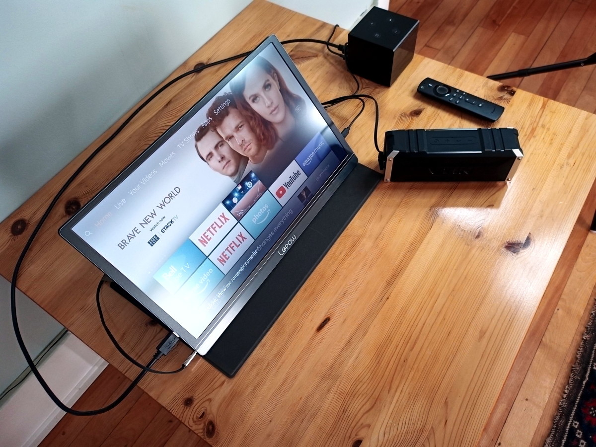 Monitor connected to a Fire TV Cube and an external speaker