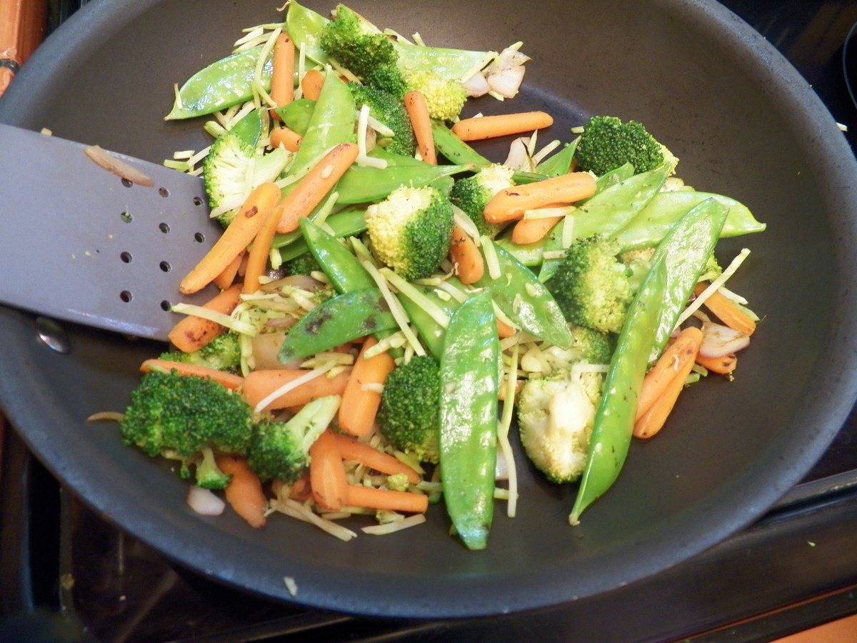 Stir fry vegetables in non-stick pan.  Use non-stick spray or 1 tea. sesame oil for flavor. When vegetables are cooked, take out of pan and set aside.