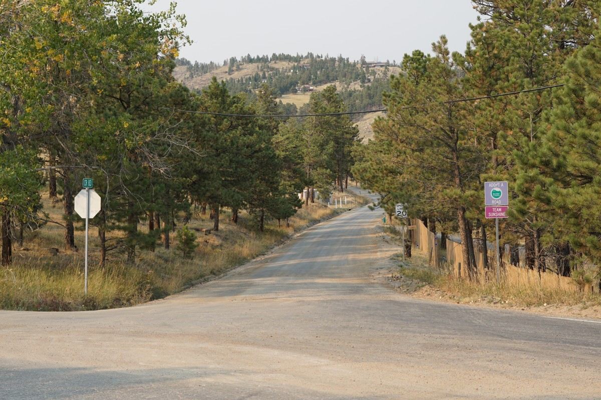 Sunshine Canyon and County Road 83 at 5.7 miles.