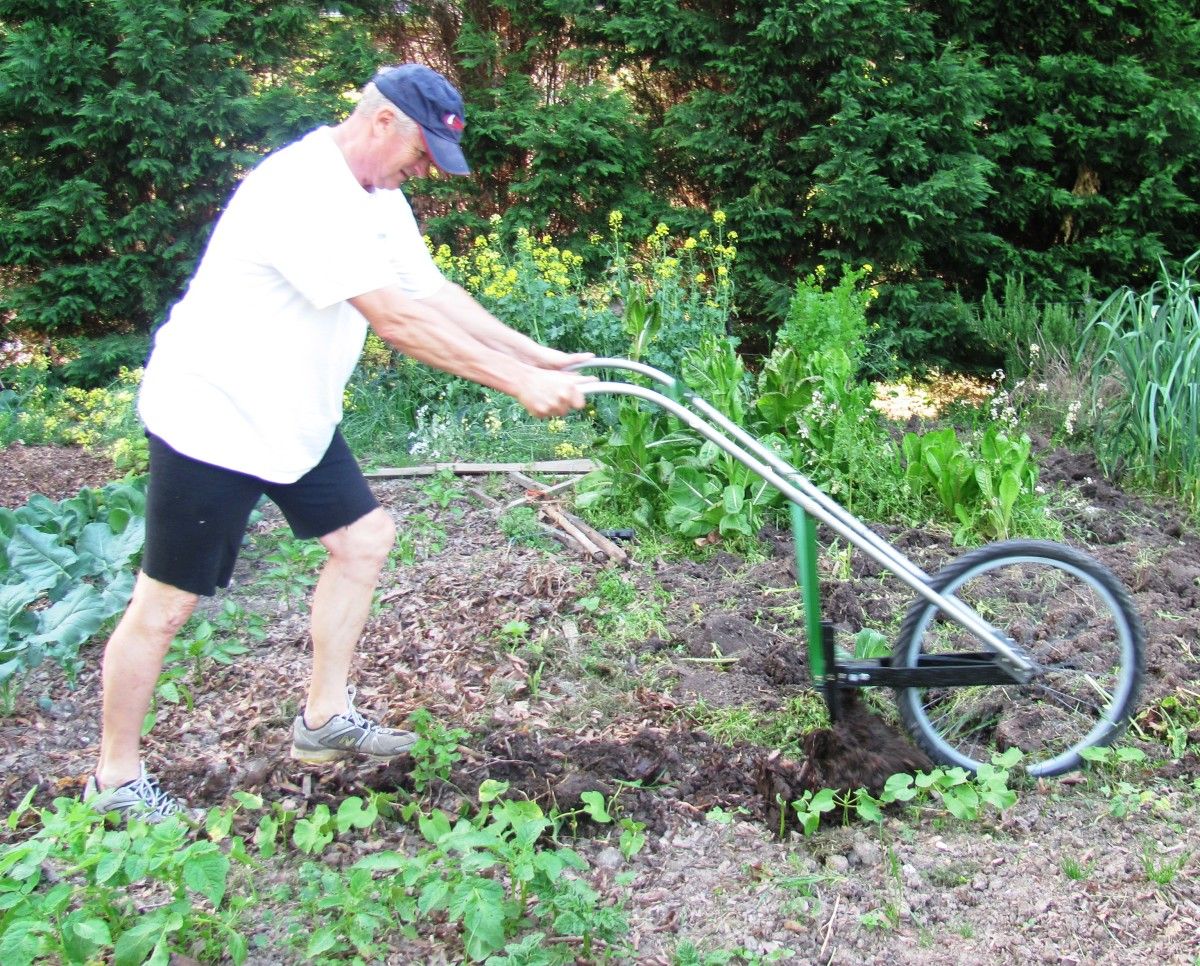 This handy garden plow used to be a discarded bike tire and other found items.