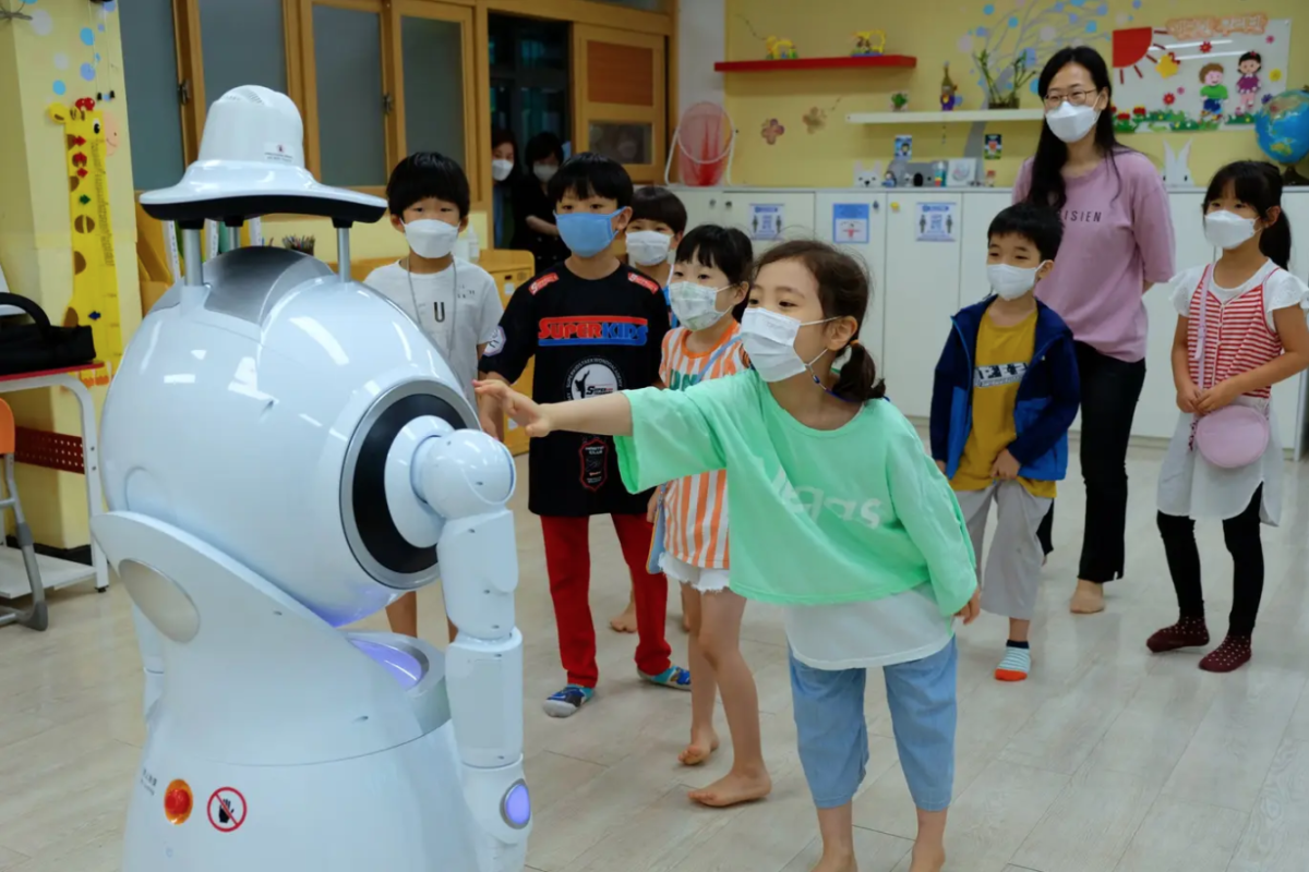 A Japanese robot appears to be having fun with children during social distancing.