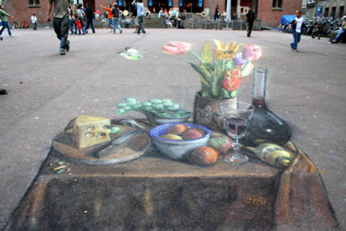 This drawing in Amsterdam is thought to be the first anamorphic still-life ever to be drawn on a pavement. The real-life arrangement was set up in situ.