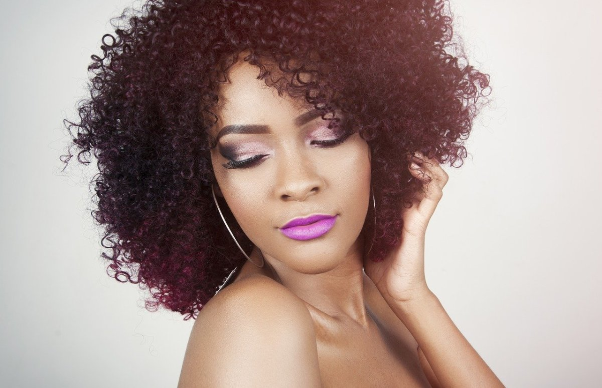 Curly hair like this is especially prone to dryness because natural oils don't travel down the hair as effectively. Brush daily to care for it properly.