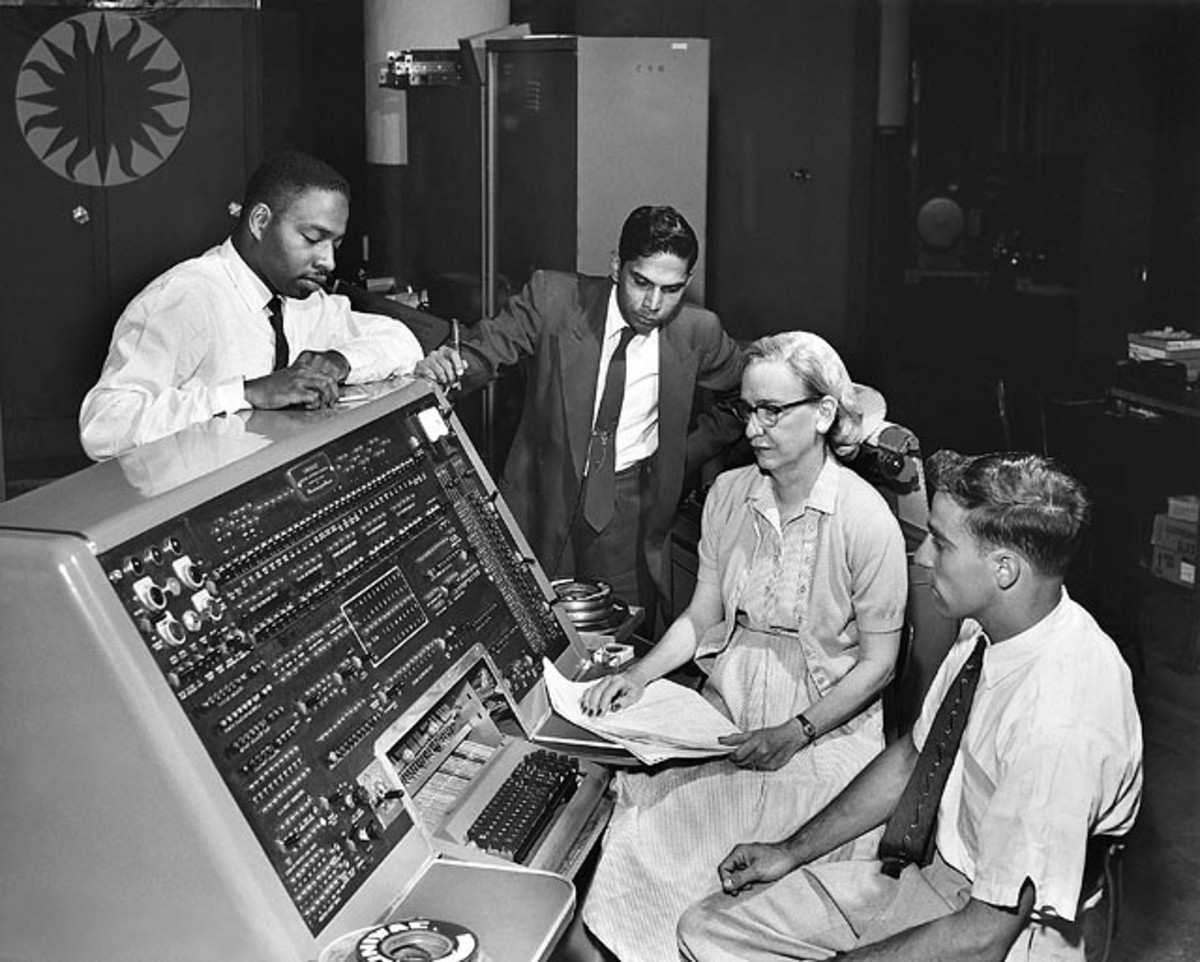Grace Murray Hopper sits at the UNIVAC I in 1960. She was an American mathematician and became Rear Admiral in the U.S. Navy as a  pioneer in developing computer technology.