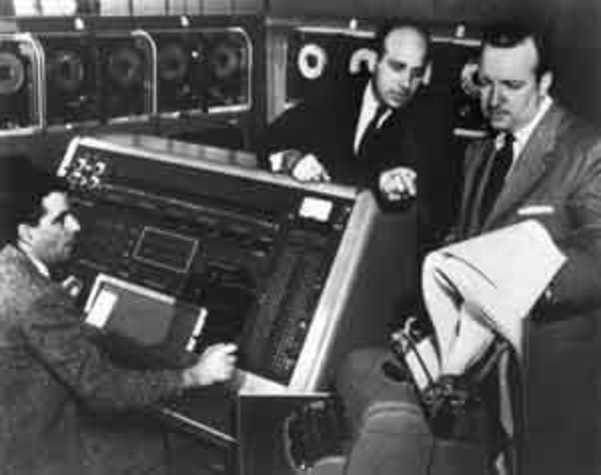 Mr. Eckert (Center) with Walter Cronkite in a UNIVAC demo.